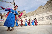 Leh Monastery, Ladakh, Jammu and Kashmir, India, Men and women dancing in square