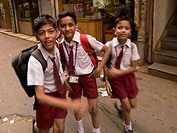 Delhi,India,Schoolboys running in the street