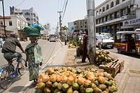 Kenyan woman carrying basket on her head at Digo Road, Downtown Mombasa, Kenya, Africa