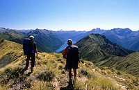 Trekker at Keppler Mountains looking at the view, Fiordland National Park, South Island, New Zealand, Oceania