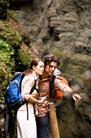 Couple hiking, man showing woman something interesting, Partnachklamm, Garmisch_Partenkirchen, Bavaria, Germany