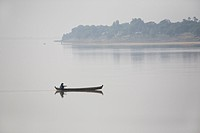 Man in a canoe on Ayeyarwady river between Mandalay and Bagan in Myanmar, Burma