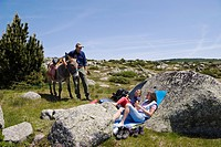 A rest during a family_hiking with a donkey in the Cevennes mountains, France