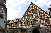 Exterior view of the Hotel and Restaurant Loewen under cloudy sky, Marktbreit, Franconia, Bavaria, Germany