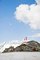 Mountain hut in a mountain landscape, Swiss Flag, St. Gotthard, Switzerland