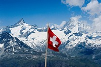 Swiss flag in a mountainous landscape, Valais, Switzerland