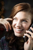 Portrait of young happy woman on the phone