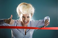 Young woman gesturing and cutting red ribbon, close_up, portrait
