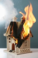 Wooden toy house on fire