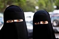 Arab women wearing traditional black Burka.