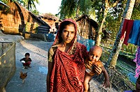 Woman with child in Joy Mun Gol village on the Bangara River, Ganges Delta, Sundarbans, Bangladesh