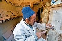 Stucco worker in the medina, Marrakech, Morocco