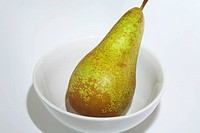 Conference pear in white bowl