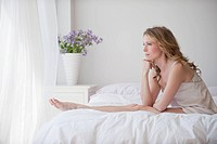 A woman relaxing in bed