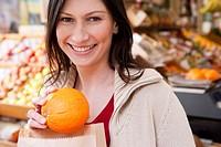 Woman holding small pumpkin