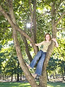 Young Girl Sat in Tree