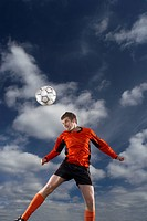 footballer heading ball