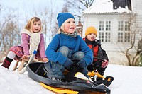 Scandinavian children on sleds