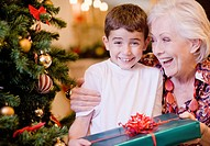 Grandmother giving grandson Christmas gift