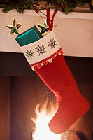 Christmas stocking hanging on fireplace mantel