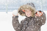 Boy throwing snowball