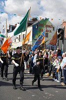 colour party of the eire nua republican flute band march down the falls road on Easter Sunday during the Easter Rising Commemoration Falls Road Belfas...