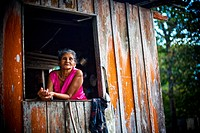 Mrs. in the Window, Santo Elias Community, Negro River, Novo Airão, Amazonas, Brazil