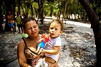 Woman with Child in the Lap, Terra Preta Community, Iranduba, Amazonas, Brazil