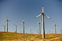 Wind turbines, or windmills, positioned on a ridge line to maximize output of electricity for public utilities in southern California