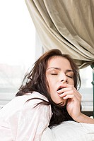 young woman yawing
