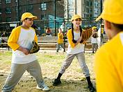 Lifestyles - Latino teens practice baseball in a city setting