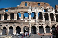 Tourists exit the rear entrance to the colosseum Rome Lazio Italy