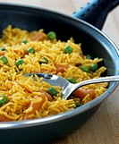 Saffron rice with carrots and peas