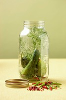 Mason jar with cucumbers and pickling spices