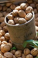 Walnuts in a measuring tub