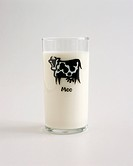 Milk in a Glass with a Cow and the Word Moo on It