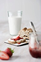 Strawberry jam with bread and milk