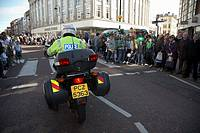 PSNI police motorcyclist clears the road at the parade and carnival on st patricks day belfast northern ireland