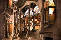 Spain, Cataluna, Barcelona, Eixample, Balcony and window details of Casa Batlo designed by the architect Antoni Gaudi