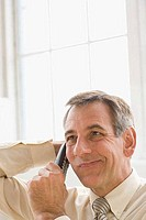 Close_up of a businessman talking on the phone