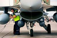 Alexsi, an Israeli Air Force, Crew Chief conducts pre-flight checks at Nellis Air Force Base before a training mission at Red Flag 09-4  Red Flag is a...