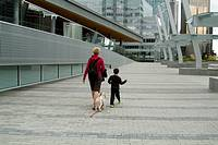 woman, boy and dog at the Vancouver Convention Centre, Vancouver, BC, Canada