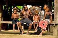 Papua New Guinea, East Sepik Province, region of Maprik, village of Kaminimbus, local place of Tapugira, Mako and Loria Kapmanda play with their child...
