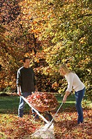Couple doing yard work in autumn