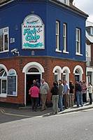 Queue in line outside Aldeburgh fish and chip shop, Suffolk