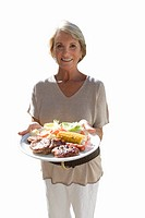 senior woman holding tray of food, cut out