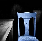 A blue chair beside a table