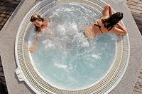 two girls in the Jacuzzi spa from above