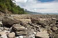 Empty boulder-strewn tropical beach, photographed in Costa Rica
