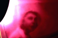 A blurred womans face in red